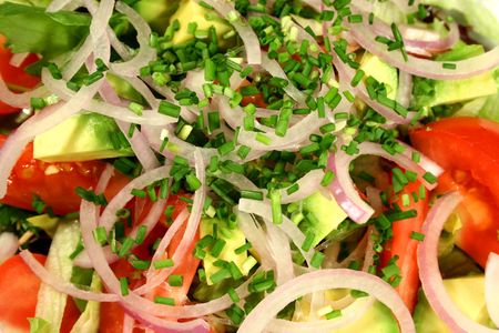 Beautiful tossed salad with fresh chives. 스톡 콘텐츠