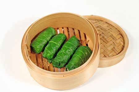 scrumptious: Delicious Asian chicken cabbage rolls in a bamboo steamer.