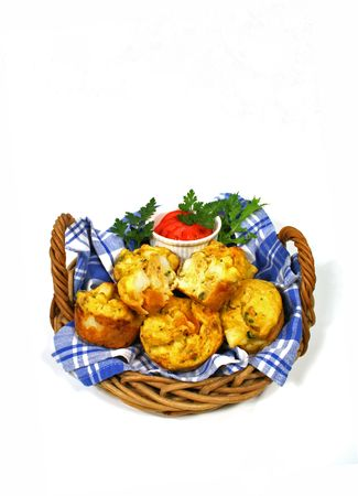 wider: Wider vertical shot of freshly baked vegetable muffins ready to serve.