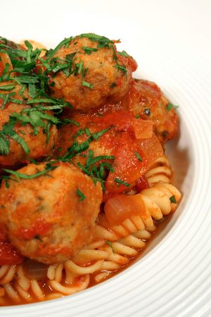 Vertical framing of delicious Italian pasta and chicken meat balls. Stock Photo - 629154