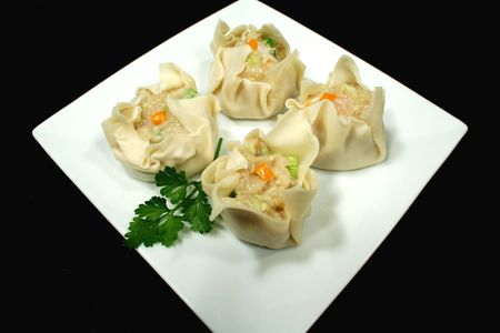 sums: Freshly prepared dim sums ready for the steamer. Stock Photo