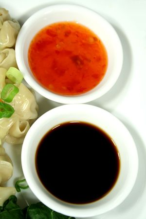 sums: Soy sauce and sweet chilli dipping sauces.