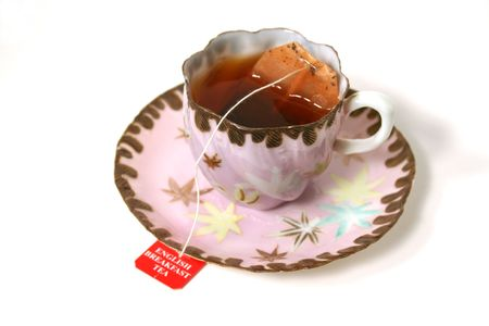 Classic antique tea cup with tea bag. Stock Photo - 690257