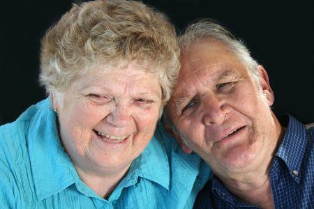 affinity: Happy senior couple enjoy a laugh.