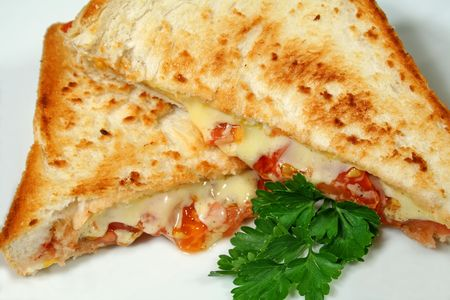 toasted: Yummy toasted cheese and tomato sandwiches with melted cheese.