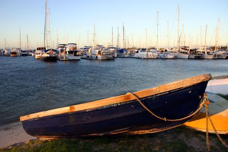 dinghies: Late afternoon light on a dinghy by the marina. Stock Photo