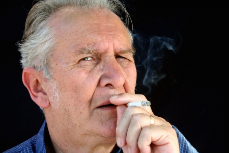 smolder: Senior dragging on a cigarette staring down the barrel.