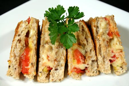 accompaniment: Yummy toasted cheese and tomato sandwiches with mustard.