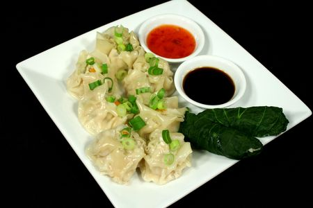 sums: Steamed dim sums and cabbage rolls ready to serve.