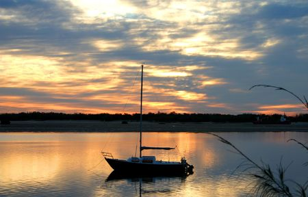 Small one man yacht moored in the calm. Stock Photo - 713032