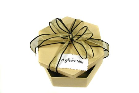 infatuation: Black and gold bow on a gift box. Stock Photo