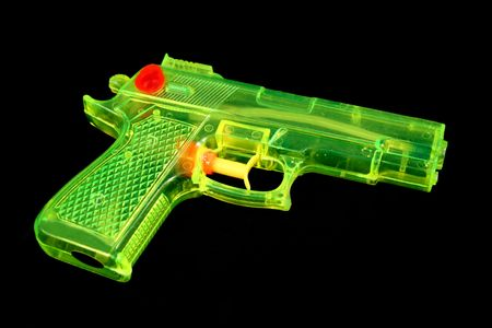 fluorescence: Fluorescent green and yellow water pistol.