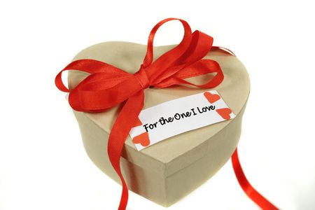 Red bow wrapped gift for a loved one. photo