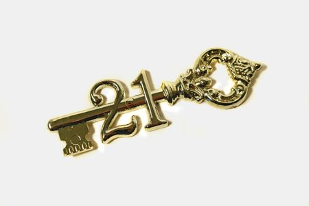 maturity: Symbolic golden 21st birthday key.