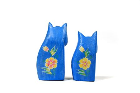 Two handcarved blue cats looking away. photo