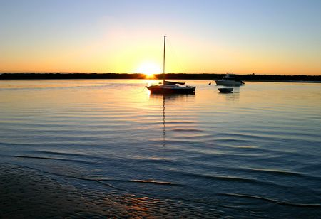 The sun rises over a safe harbour. Stock Photo - 770025