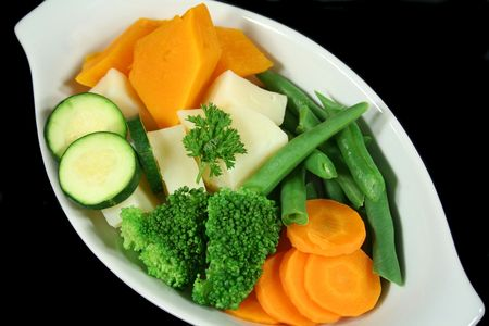 Freshly steamed vegetables ready to be served.