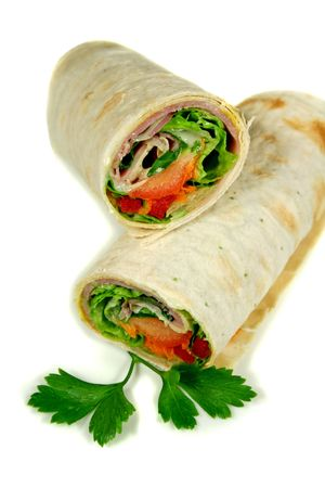 freshly: Freshly prepared ham and salad wrap ready to eat.