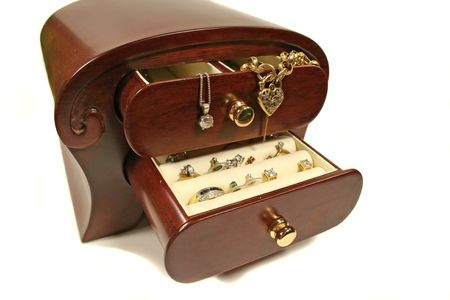 jewellery box: Polished wood jewellery box with valuables. Stock Photo