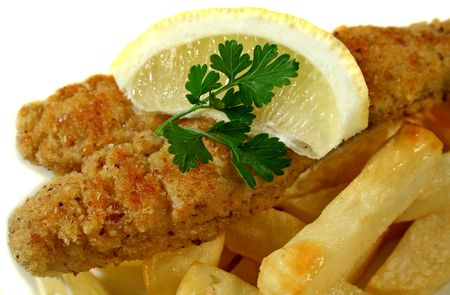Fresh pan fried whiting with lemon and fries.