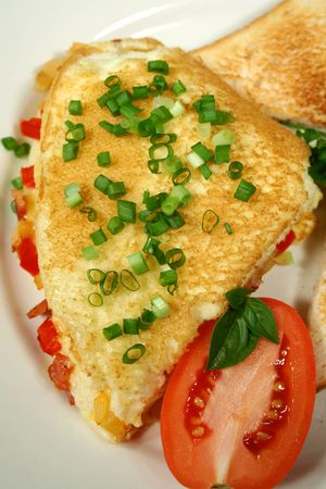 freshly: Freshly cooked omelette with toast and tomato.