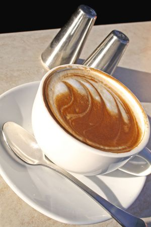 Flat white coffee ready to drink. Stock Photo