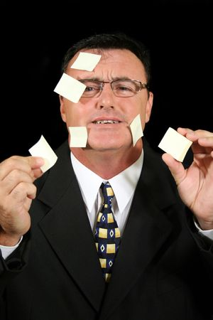 baffled: Busy salesman confused with his Post-it Notes.