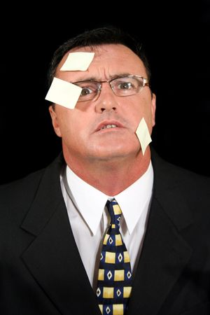 marketeer: Stunned salesman completely confused with his Post-it notes.  Stock Photo