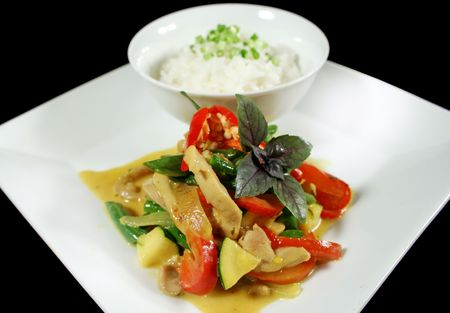 thai pepper: Delicious creamy Thai chicken curry with vegetables ready to go.