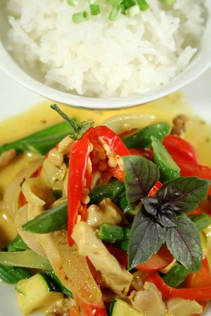 delectable: Delicious creamy Thai chicken curry with vegetables ready to go.