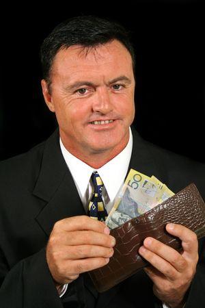 gratified: Smug salesman has made more money than he thought he had.