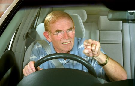 road rage: Middle aged man exploding with road rage.