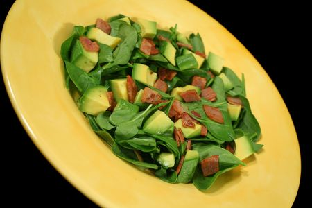 Delightful  spinach, avocado and bacon salad ready to serve.