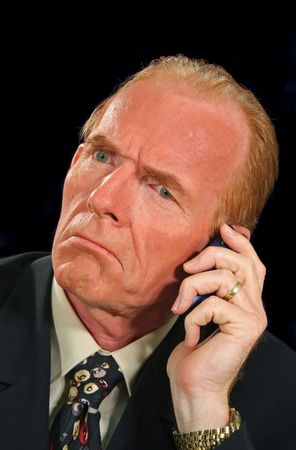 Perplexed businessman takes a confusing phone call. photo