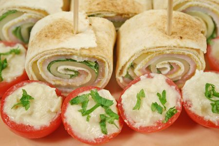 ham and cheese: Bite size roll ups with ham, cheese and spinach and stuffed cherry tomatoes.