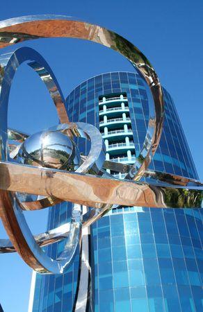 moderm: Ultra modern corporate high rise with chrome decorative piece.