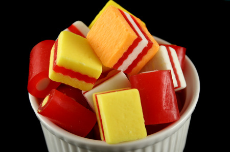 fatter: Colorful striped fruit flavored candies ready to eat.