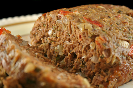homestyle: Freshly baked homestyle lamb meatloaf just carved. Stock Photo