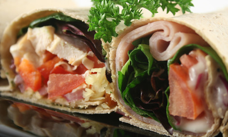delectable: Mixed platter of delicious ham and chicken salad wraps.