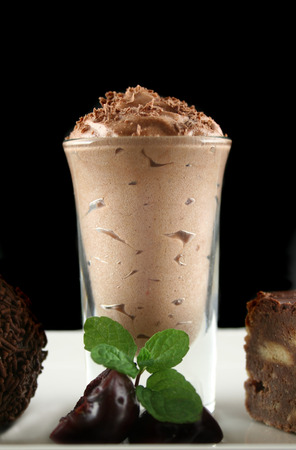 rich flavor: Triple chocolate treat of a rum ball and chocolate mousse and slice. Stock Photo