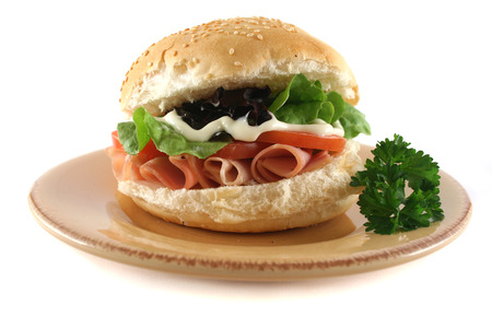 freshly prepared: Freshly prepared ham and salad roll with mayo. Stock Photo
