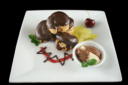 rich flavor: Chocolate profiteroles with kiwi fruit and ice cream.