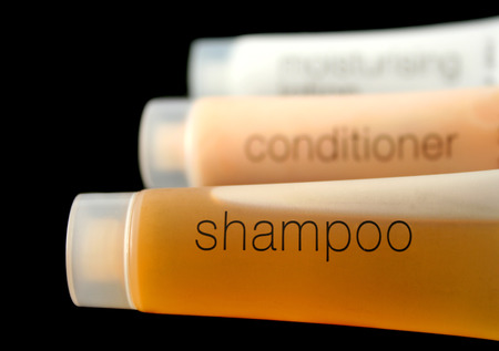 Tubes of shampoo, conditioner and moisturizing lotion. Stock Photo