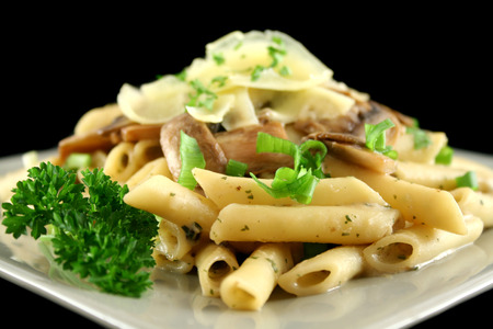 delectable: Creamy mushroom penne pasta with shredded cheese.