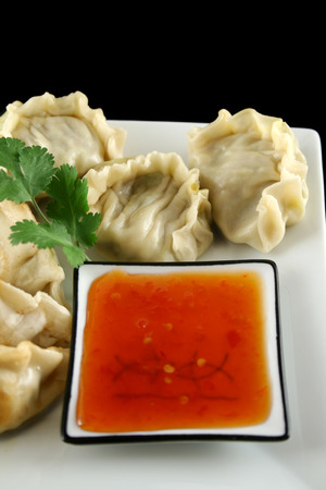 unprocessed: Delicious fried pork and vegetable Chinese dumplings ready to serve.