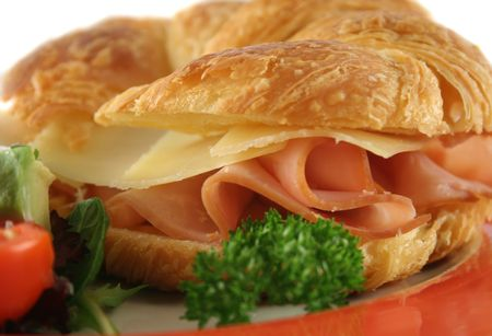 unprocessed: Delicious ham and cheddar cheese croissant with salad. Stock Photo