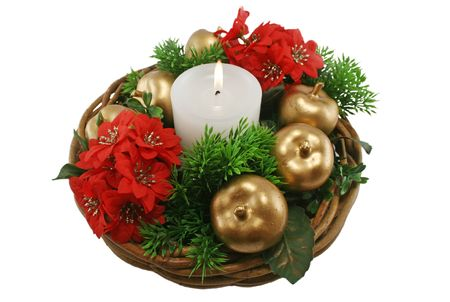 meaningful: Christmas basket arrangement with candle, golden apples and foliage.