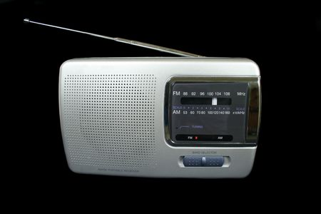 tune: Old style portable radio with antenna. Stock Photo