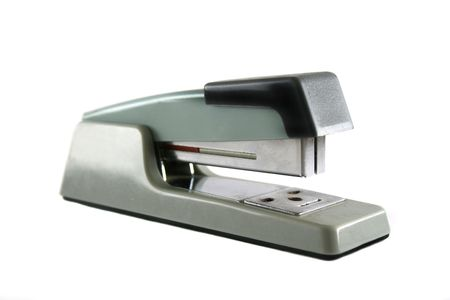 chrome base: Old well used metal stapler for the office.