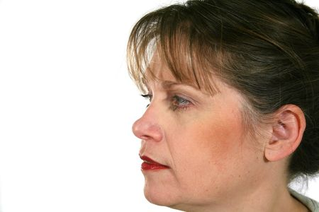 envisage: Profile of middle aged woman looking forward.